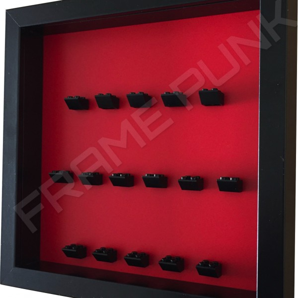 Black Lego brick formation on red background side view