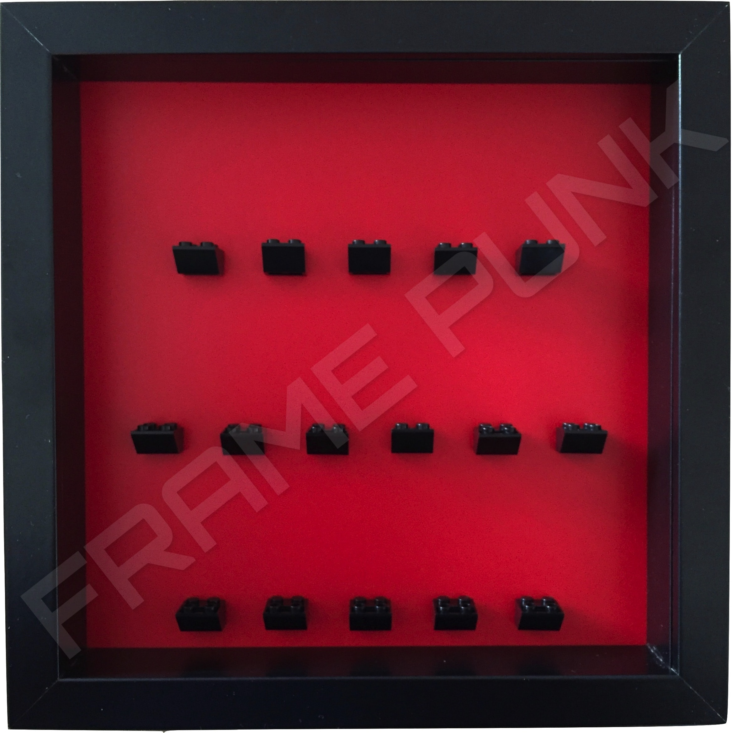 Black Lego brick formation on red background