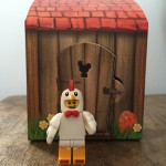 Lego Easter Chicken Man minifigure standing by his house