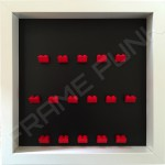 Red Lego brick formation on black background white frame