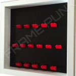 Red Lego brick formation on black background white frame side view