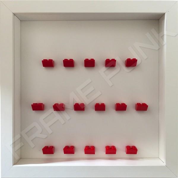 Red Lego brick formation on white background white frame