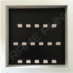 White Lego brick formation on black background white frame