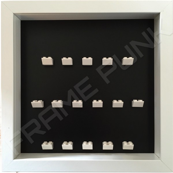 White Lego brick formation on black background white frame