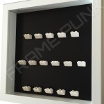 White Lego brick formation on black background white frame side view