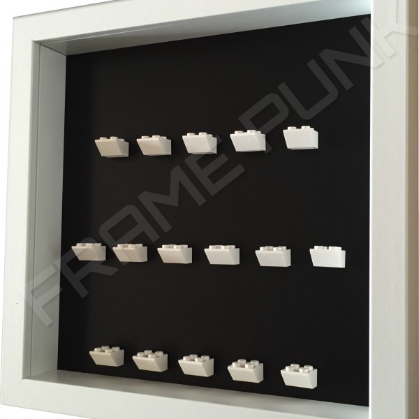 White Lego brick formation on black background white frame side view