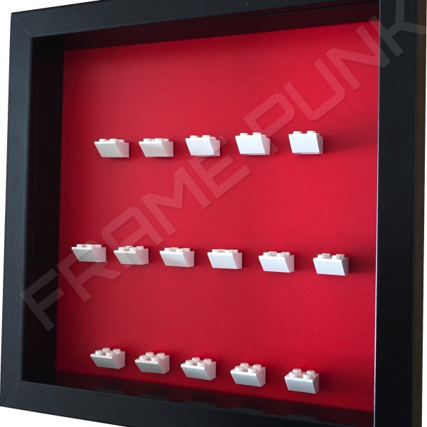 White Lego brick formation on red background side view