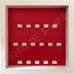 White Lego brick formation on red background white frame