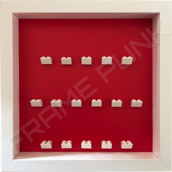 White Lego brick formation on red background white frame