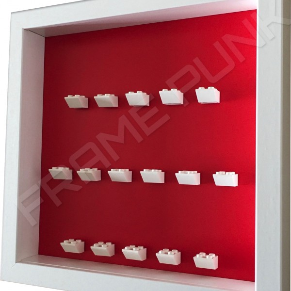 White Lego brick formation on red background white frame side view