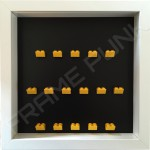 Yellow Lego brick formation on black background white frame