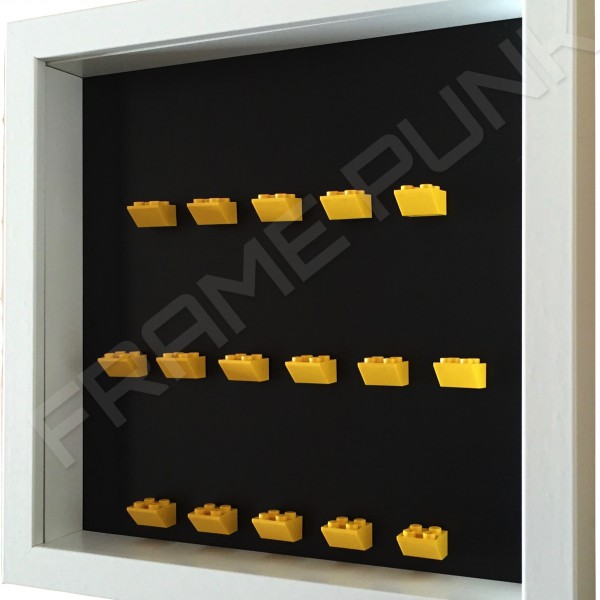 Yellow Lego brick formation on black background white frame side view