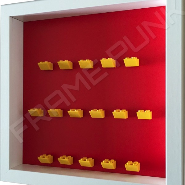 Yellow Lego brick formation on red background side view