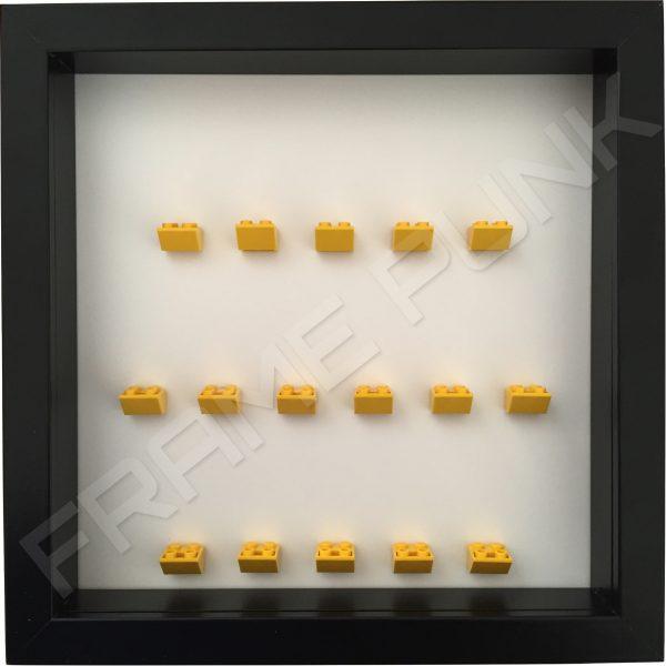 Yellow Lego brick formation on white background