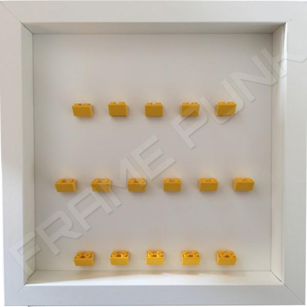 Yellow Lego brick formation on white background white frame
